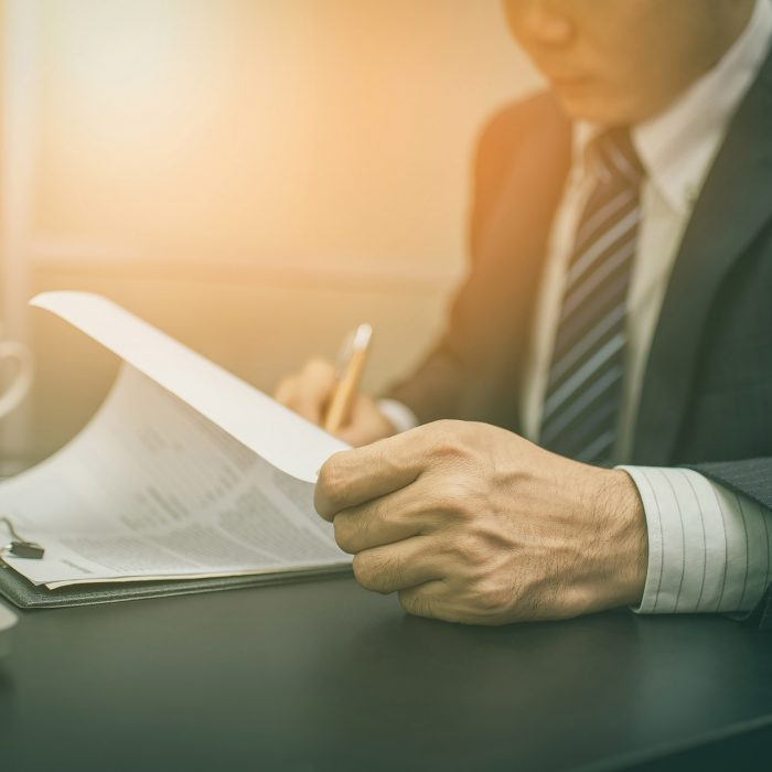 Business man reviewing documents
